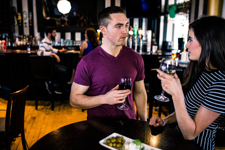 high def: Couple having an aperitif with wine in a bar