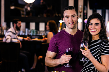 high def: Portrait of couple having a glass of wine in a bar Stock Photo