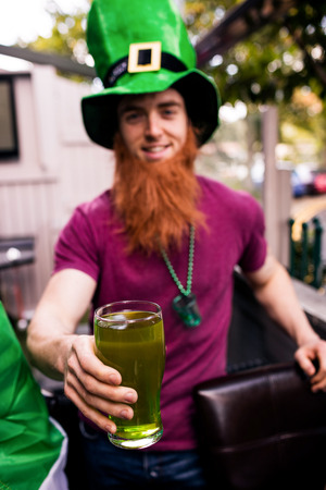 st  patty: Disguised man holding a green pint for St Patricks day