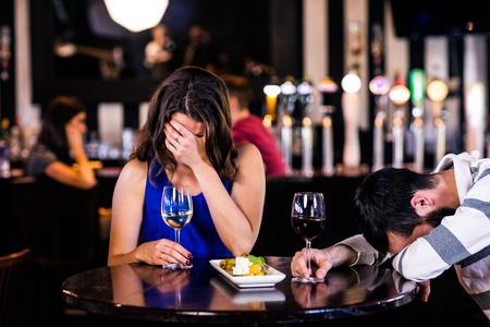 high def: Couple laughing and having a drink in a bar