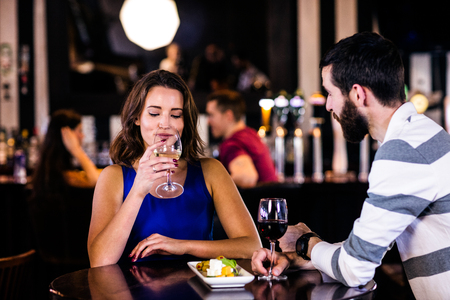 high def: Couple having a drink in a bar