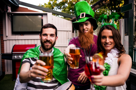 saint patty: Friends celebrating St Patricks day with drinks