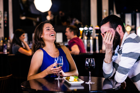 high def: Couple having a glass of wine in a bar
