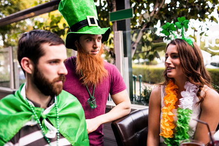 saint patty: Friends celebrating St Patricks day outside Stock Photo