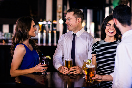 high def: Friends talking and having a drink in a bar