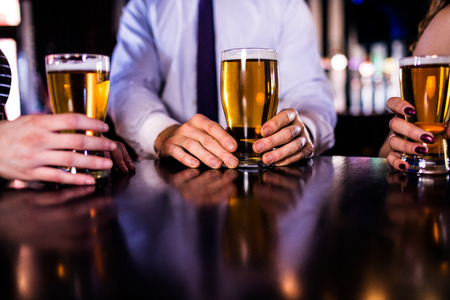 high def: Friends having a beer in a bar Stock Photo