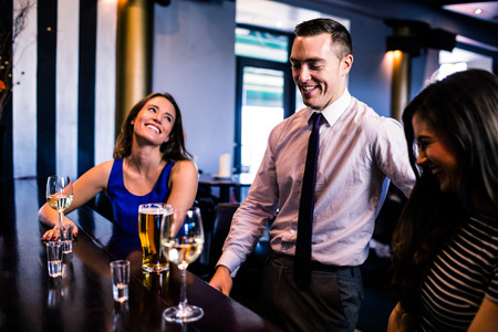 high def: Friends talking and drinking in a bar
