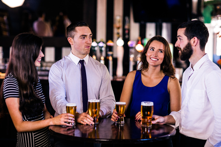 high def: Friends talking and having a beer in a bar