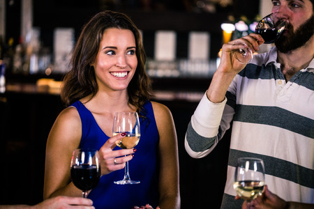 high def: Friends having a glass of wine in a bar