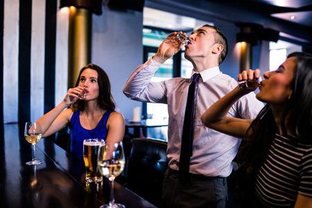 high def: Friends drinking shots in a bar