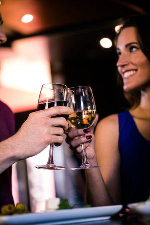 high def: Couple toasting with a glass of wine in a bar