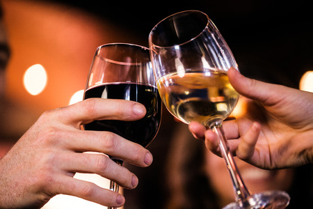 high def: Close up of friends toasting with red and white wine