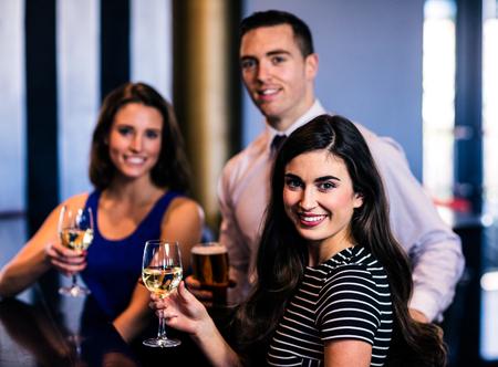 high def: Friends having a drink in a bar
