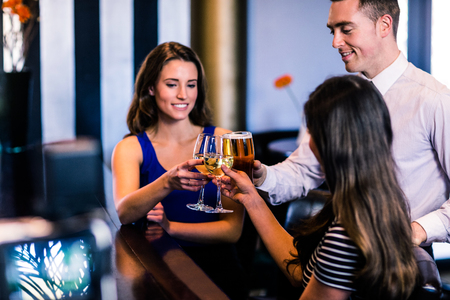 high def: Friends toasting together in a bar
