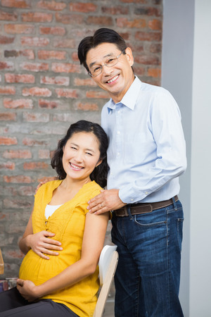 expectant: Portrait of happy expectant couple at home