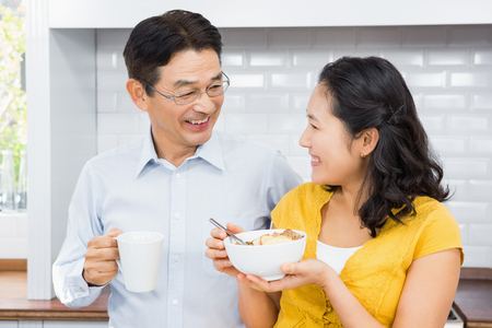expectant arms: Happy expectant couple in the kitchen in the morning Stock Photo