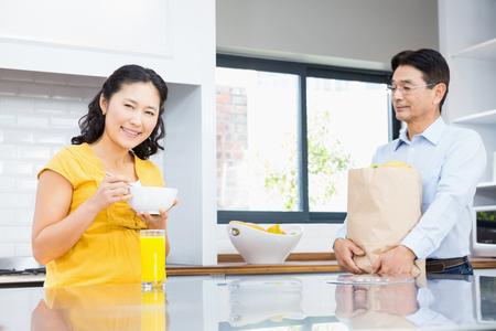 expectant: Happy expectant couple in the kitchen in the morning Stock Photo