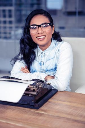 typewriting: Asian woman typewriting in office