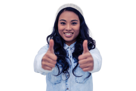 Asian woman showing thumbs up on white screen Banco de Imagens