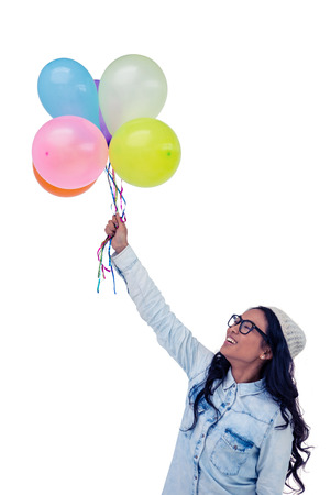 pre adult: Asian woman holding colorful balloons on white screen Stock Photo