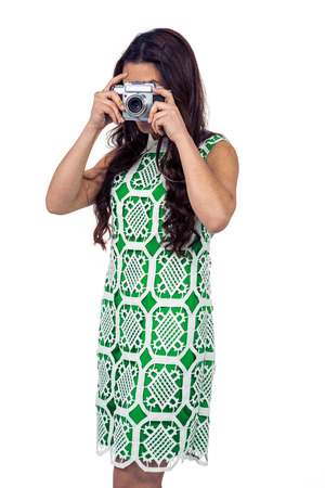 pre adult: Asian woman taking picture with digital camera on white screen