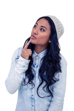 pre adult: Asian woman with finger on chin on white screen