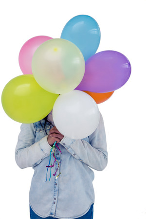 pre adult: Asian woman hiding her face behind colorful balloons on white screen