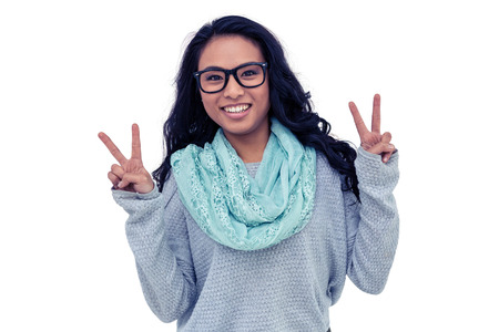 pre adult: Asian woman making peace sign with hand on white background Stock Photo