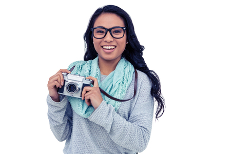 pre adult: Asian woman holding digital camera on white screen