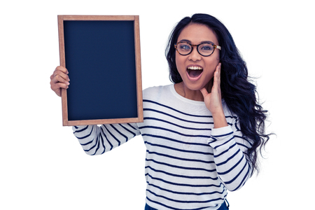 pre adult: Surprised Asian woman holding blackboard on white screen