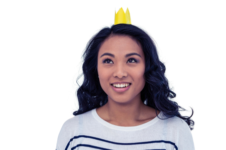Smiling Asian woman with paper crown on white screen