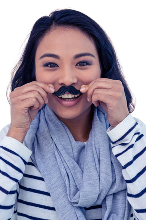 pre adult: Pretty Asian woman with fake mustache posing for camera on white screen