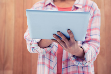midsection: Midsection of woman using tablet Stock Photo