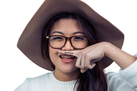 pre adult: Asian woman with mustache on finger posing for the camera on white screen
