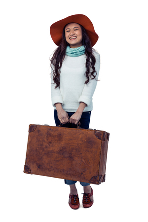 pre adult: Smiling Asian woman holding luggage on white screen