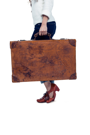 midsection: Midsection of woman holding luggage on white screen