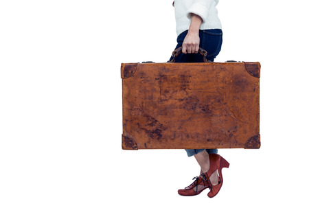 pre adult: Midsection of woman holding luggage on white screen