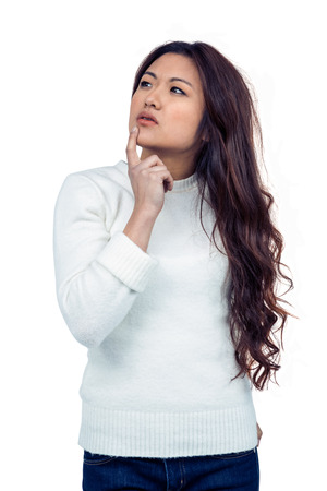 pre adult: Thoughtful Asian woman with finger on chin on white screen