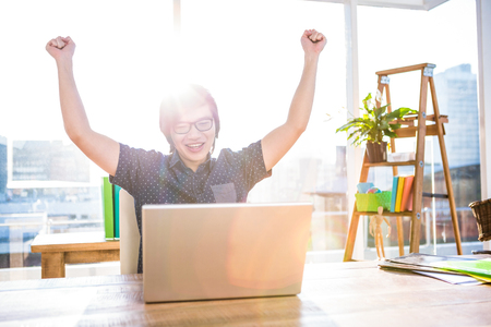 happy asian people: Cheerful asian businessman using laptop in office