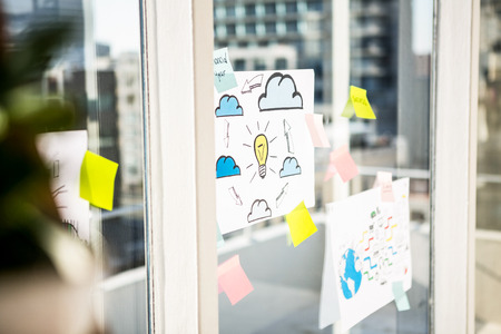 page down: Adhesive notes on window in office