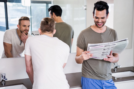 couple bathroom: Smiling gay couple in the bathroom at home Stock Photo