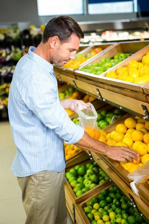 choosing: Man choosing his groceries at the supermarket