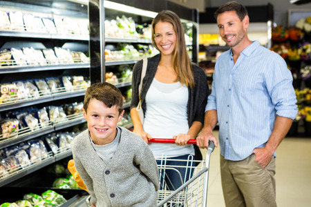 store: Smiling family doing shopping in grocery store