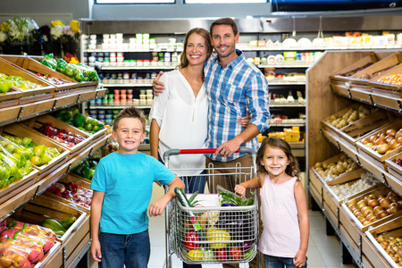 grocery shelves: Portrait of family doing shopping in grocery store