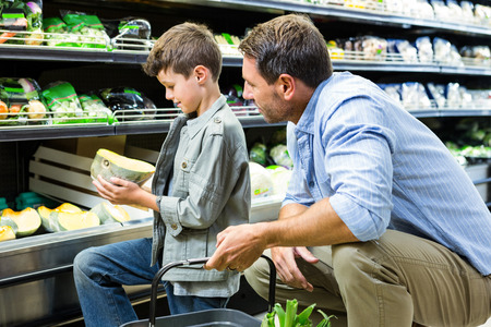 grocery shelves: Father and son shopping in the grocery store Stock Photo
