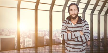 hooded shirt: Portrait of hipster with hooded shirt against room with large window looking on city Stock Photo