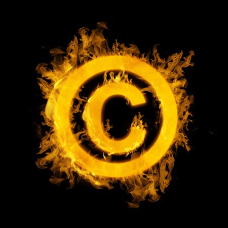 duplication: Copywrite   in fire against black Stock Photo