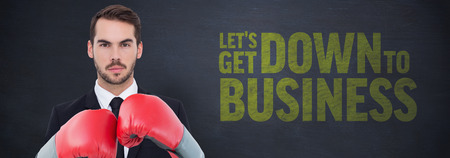 buzz: Businessman wearing boxing gloves beside buzz words