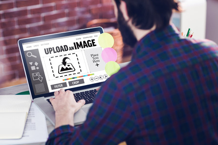graphic designing: Designer interface against rear view of creative editor working on laptop Stock Photo