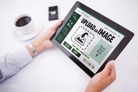 using tablet: Man using tablet pc against designer interface